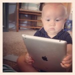 Baby reading a tablet